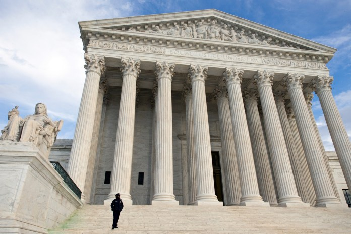 The Supreme Court is seen in Washington, Wednesday, Feb. 17, 2016, as preparations are being made to honor Justice Antonin Scalia, who died over the weekend at age 79. (AP Photo/J. Scott Applewhite)