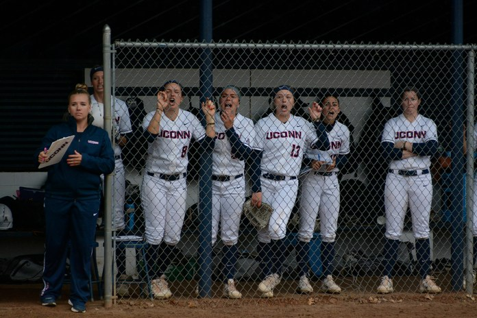The UConn softball celebrates during a game last season at the Connecticut Softball Stadium. (Jason Jiang/The Daily Campus)