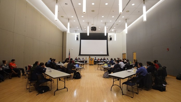 The USG Judiciary meets in the Student Union Ballroom. In their last session, USG appointed one justice too many, bringing the total to six. Their constitution stipulates that only five justices can serve at once. (Erming Gao/The Daily Campus)