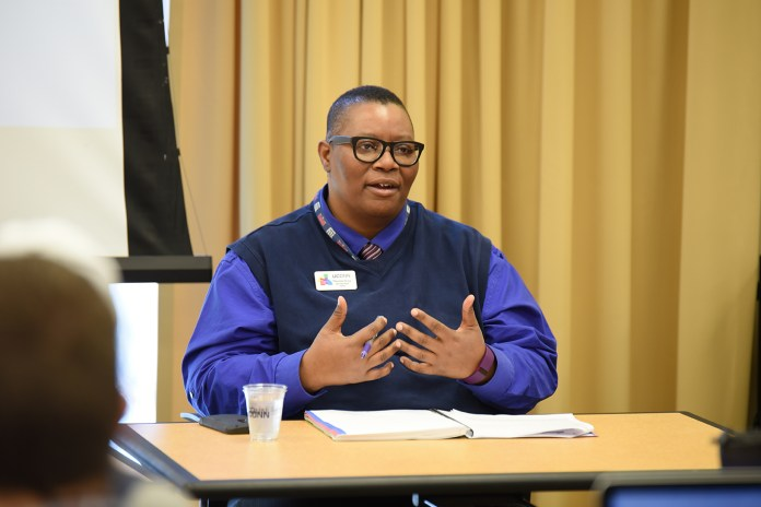 """Fleurette King, director of UConn's Rainbow Center, speaks during a panel discussion """"Issues in Sports: Diversity in Sports Leadership"""" in the Charles B. Gentry Building in Storrs, Connecticut on Thursday, Feb. 25, 2016. (Allen Lang/The Daily Campus)"""