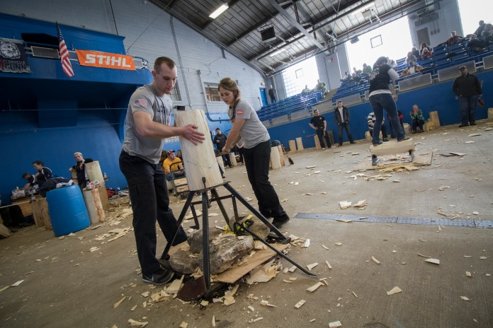 Members of the UConn Woodsmen get a log situated between events at the 5th Annual Jack and Jill Meet at the Ratcliffe Hicks Arena in Storrs, Connecticut on Saturday, Feb. 27, 2016. (Jackson Mitchell/The Daily Campus)
