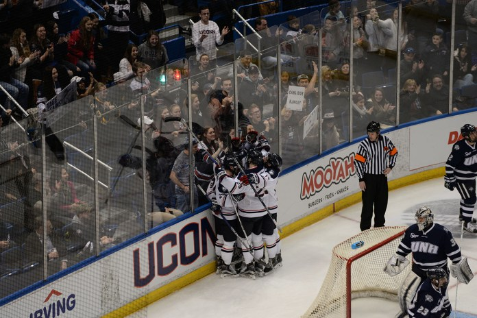 UConn celebrates after scoring a goal during their 4-1 victory over UNH at the XL Center on Friday Feb. 26, 2016. The Huskies will host Vermont in the Hockey East playoffs next weekend. (Amar Batra/The Daily Campus)