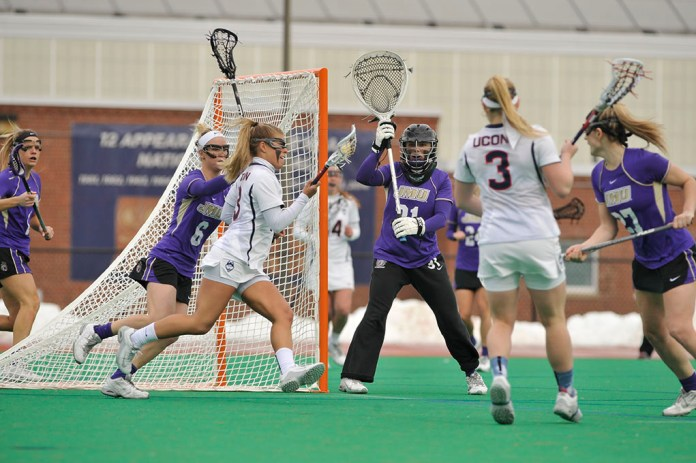The UConn lacrosse team improved to 3-0 on the season with a victory on Saturday over UNH. (Jason Jiang/The Daily Campus)