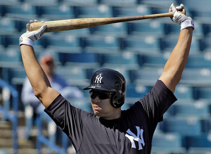 New York Yankees' Alex Rodriguez stretches before taking batting practice during a spring training baseball workout Saturday, Feb. 27, 2016, in Tampa, Fla. (AP Photo/Chris O'Meara)