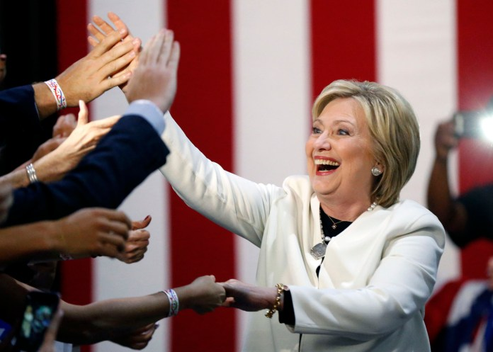 Democratic presidential candidate Hillary Clinton reacts to supporters as she arrives to address supporters at herSuper Tuesday election night rally in Miami,Tuesday, March 1, 2016. (AP Photo/Gerald Herbert)