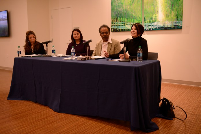 """Carolyn Treiss, executive director of the Permanent Commission on the Status of Women, speaks during """"Amplifying the Voices on the Ground,"""" a panel discussion held in the Jorgensen Gallery in Storrs, Connecticut on Saturday, March 5, 2016. (Jason Jiang/The Daily Campus)"""