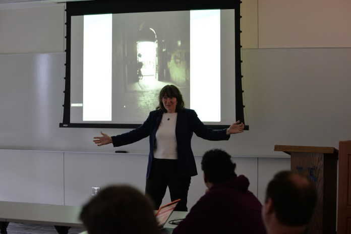 Carol Gray speaks during her presentation in Oak Hall about living through the Egyptian Revolution on Monday, March 7, 2016. (Amar Batra/The Daily Campus