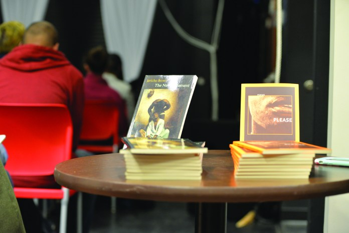 """Jericho Brown's books, """"New Testament"""" and """"Please,"""" at the event.Students were overwhelmingly pleased with his reading, calling it """"moving."""" (Amar Batra/Daily Campus)"""