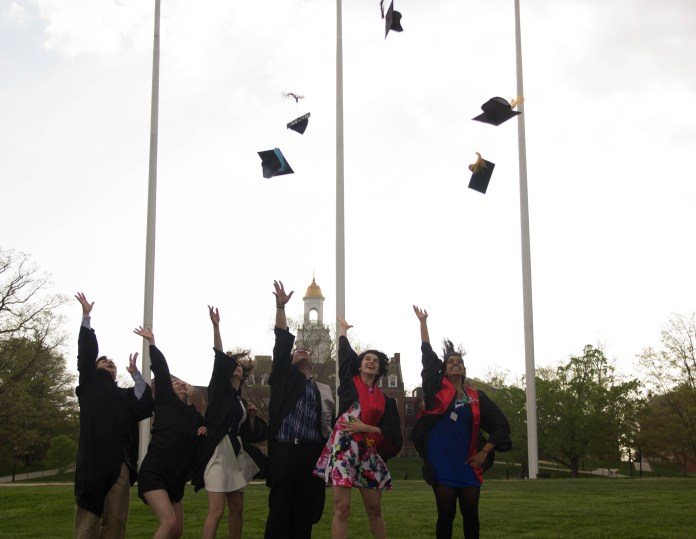 Members of the class of 2015 throw their hats into the air on the Great Lawn in front of Wilbur Cross. The class of 2020 is still accepting members, post-January 15 application deadline, said Nathan Fuerst, direcot of admissions. According to Fuerst,It's normal for schools to accept late applications. (Amar Batra/Daily Campus)