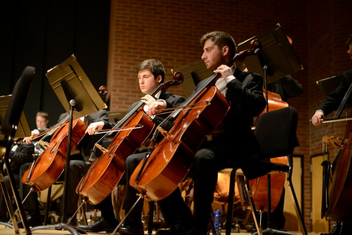 Members of the UConn Symphony Orchestra's cello section perform during a concert at von der Mehden Recital Hall in Storrs, Connecticut on Thursday, March 10, 2016. (Jason Jiang/The Daily Campus)