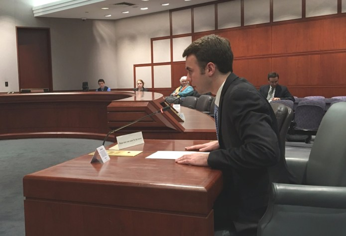 Undergraduate trustee-elect Adam Kuegler speaks at a higher education committee public hearing in Hartford on Tuesday, March 8, 2016 advocating for additional student trustees. (Kyle Constable/Daily Campus)