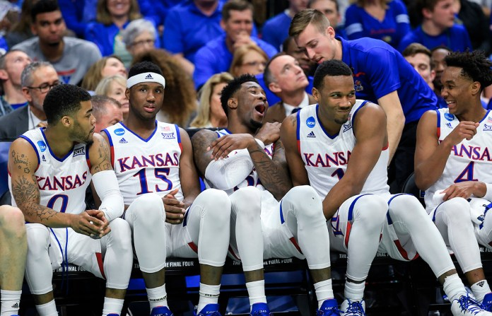Kansas players from left to right: Frank Mason III (0), Carlton Bragg Jr. (15), Jamari Traylor (31), Wayne Selden Jr. (1) and Devonte' Graham (4), joke on the bench in the last minutes of a first-round men's college basketball game against Austin Peay in the NCAA Tournament in Des Moines, Iowa, Thursday, March 17, 2016. (AP Photo/Nati Harnik)