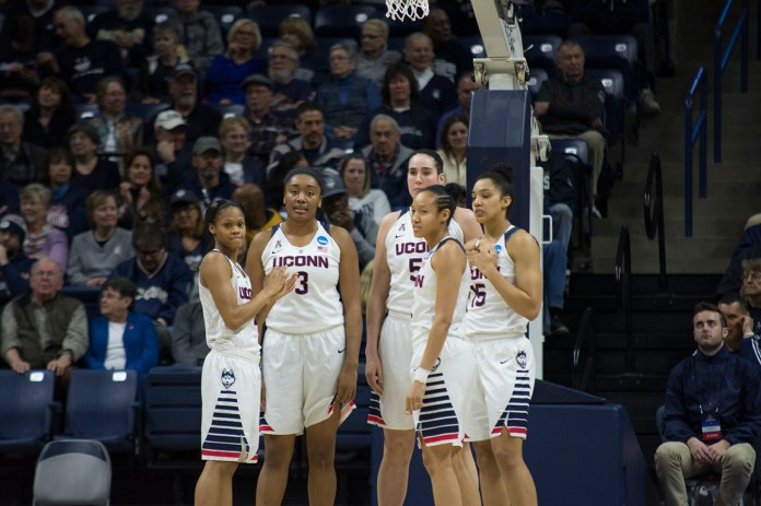 From left, Moriah Jefferson, Morgan Tuck, Natalie Butler, Saniya Chong and Gabby Williams huddle during UConn's 101-49 victory over Robert Morris in the opening round of the NCAA tournament at Gampel Pavilion on Saturday March 19, 2016. (Bailey Wright/The Daily Campus)