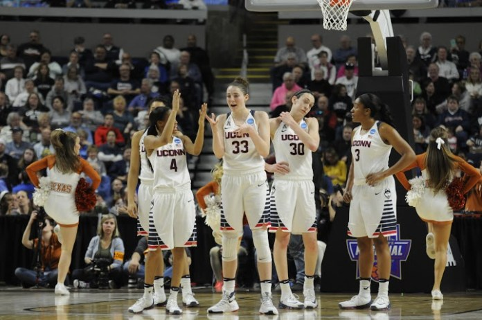 From left to right: Moriah Jefferson, Katie Lou Samuelson, Brianna Stewart and Morgan Tuck rest during a timeout on Monday, March 28 at the Webster Bank Arena in Bridgeport, Connecticut. Samuelson recorded nine points with six rebounds en route to an 86-65 victory over Texas. (Bailey Wright/The Daily Campus)