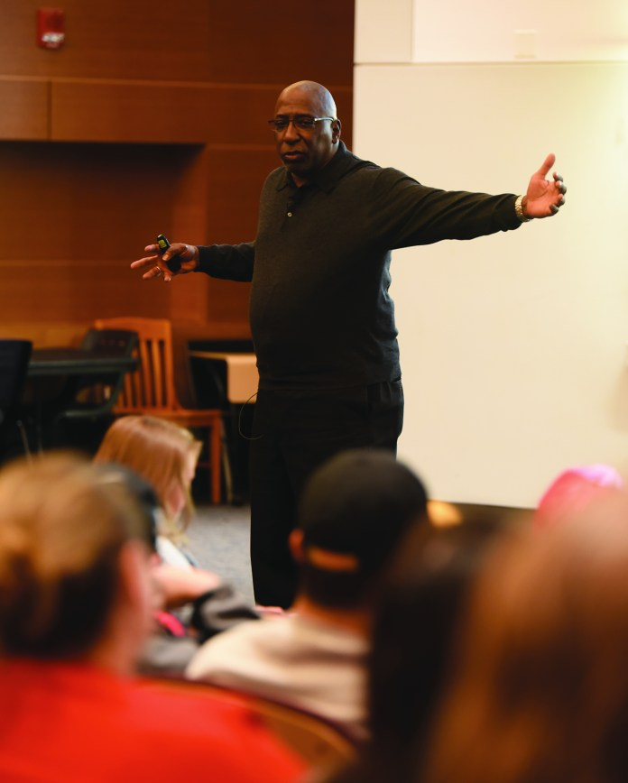 Tony Porter, activist, educator and TED Talk host, speaks to a crowded room of students in Laurel Hall about masculinity on Tuesday, March 29, 2016. (Zhelun Lang/Daily Campus)