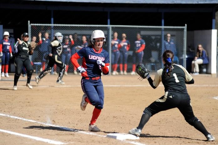 UConn softball senior Jacklyn DuBois runs toward first base during the Huskies' game against Bryant University in Storrs, Connecticut on Wednesday, March 30, 2016. (Jason Jiang/The Daily Campus)