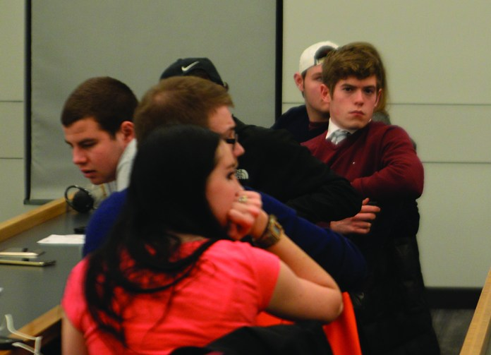 CLAS Sen. Tim Sullivan looks on during an Undergraduate Student Government during an abortion debate hosted by the UConn College Republicans on Tuesday, Feb. 16, 2016. Sullivan resigned Wednesday after allegedly attempting to buy the support of an Undergraduate Student Government justice. (Amar Batra/The Daily Campus)