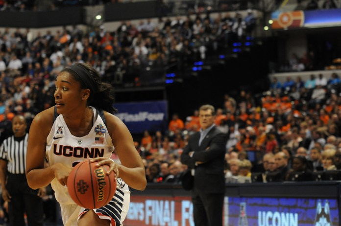 Forward Morgan Tuck attacks the basket during UConn's 80-51 victory over Oregon State in the national semifinal at Lucas Oil Stadium in Indianapolis, Ind. on Sunday April 3, 2016. Tuck was selected as a WBCA All-American. (Bailey Wright/The Daily Campus)