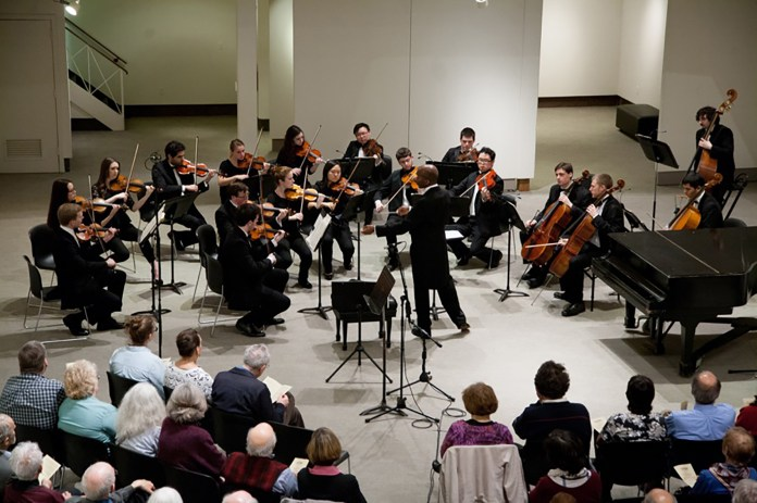 Harvey Felder, conductor and director of UConn's orchestral studies program, conducts the UConn Chamber Orchestra during a performance in the William Benton Museum of Art in Storrs, Connecticut on Friday, April 1, 2016. (Courtesy/Andy Hudymyak/YPM Photography)