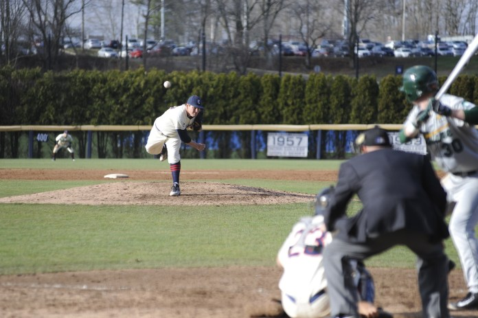 UConn pitcher Trevor Holmes fires a pitch to a Tulane hitter during a 14-5 loss on Saturday, April 2 at J.O. Christian Field. UConn will head to Northeastern to take on the Huskies.(Jason Jiang/The Daily Campus)