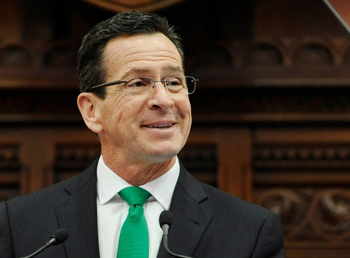 In this Jan. 7, 2015, file photo, Connecticut Gov. Dannel P. Malloy smiles during the State of the State address to a joint session of the legislature in the House Chambers at the Capitol in Hartford, Conn.(AP Photo/Jessica Hill, File)