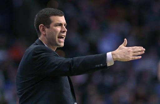 Boston Celtics head coach Brad Stevens calls to his players during the first quarter of an NBA basketball game against the Toronto Raptors in Boston, Wednesday, March 23, 2016. (AP Photo/Charles Krupa)