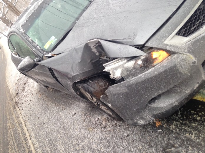 The damage to UConn commuter student Alexandra Favret's car, which came after an accident during Favret's commute from Uncasville, Connecticut to Storrs, Connecticut on Monday, April 4, 2016. (Kyle Constable/The Daily Campus)
