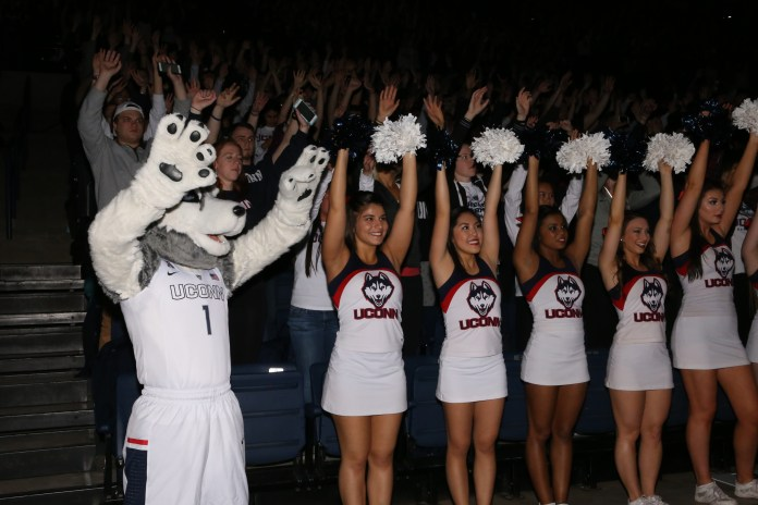 Cheerleaders raise their pom poms in Gampel Pavillion at the screening of the NCAA women's championship game between UConn and Syracuse. The game was played at the Bankers Life Fieldhouse in Indianapolis, Ind., on Tuesday, April 5, 2016. (Jackson Haigis/Daily Campus)