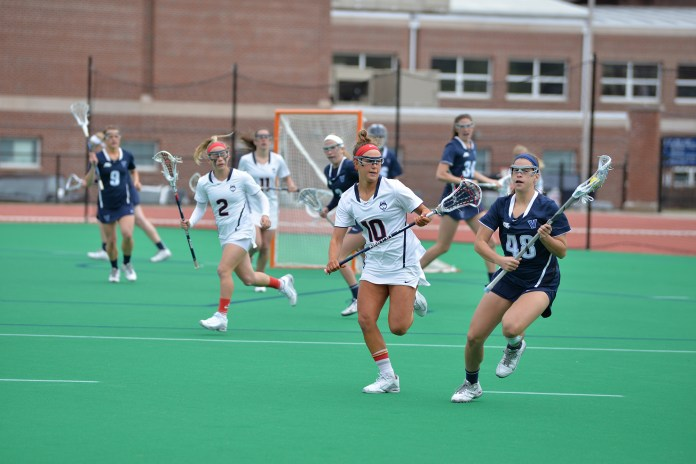 UConn lacrosse sophomore attack Grace Nolan runs upfield during the Huskies' game against Villanova at the George J. Sherman Family Sports Complex in Storrs, Connecticut on Saturday, March 26, 2016. (Amar Batra/The Daily Campus)