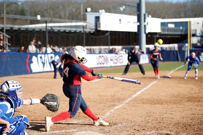 Ally Hernandez makes contact during UConn's 6-0 victory over CCSU at the Burrill Family Field on Wednesday April 13, 2016. Hernandez hit a grand slam in the game. (Tyler Benton/The Daily Campus)