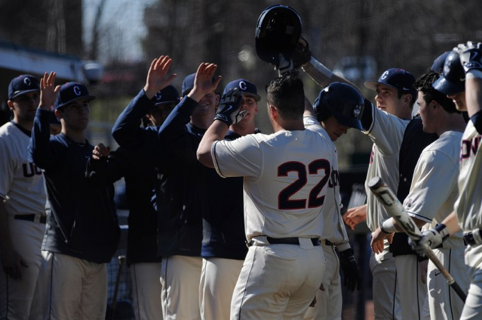 Teammates celebrate with Joe DeRoche-Duffin (22) after his home run during UConn's 6-3 win over Bryant at J.O. Christian on Wednesday April 13, 2016. (Jason Jiang/The Daily Campus)