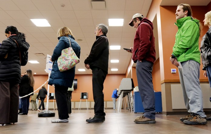 Voters wait in line to cast their ballots at the Pleasant Valley Town Hall and Fire Station Tuesday, April 5, 2016, in Eleva, Wis. Wisconsin  voters are expected to turn out Tuesday in large numbers for the presidential primary and statewide races. (Marisa Wojcik/The Eau Claire Leader-Telegram via AP)