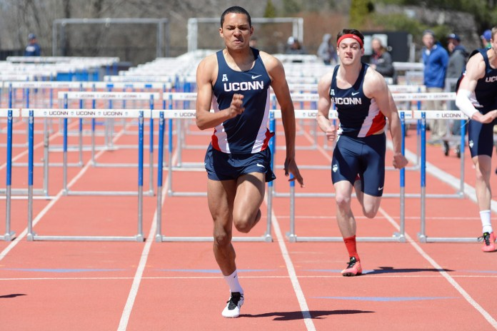 Members of the UConn men's track and field team participate in the hurdles event during a meet last spring. Five schools will travel to Storrs to compete in the UConn Northeast Challenge over the weekend. (Jason Jiang/The Daily Campus)