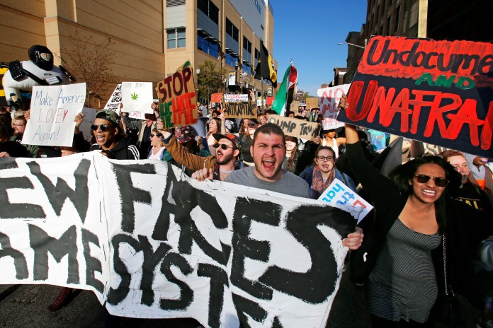 A group of protesters march through downtown Pittsburgh to the David Lawrence Convention Center to protest a visit by Republican presidential candidate Donald Trump in Pittsburgh, Wednesday, April 13, 2016. (AP Photo/Gene J. Puskar)
