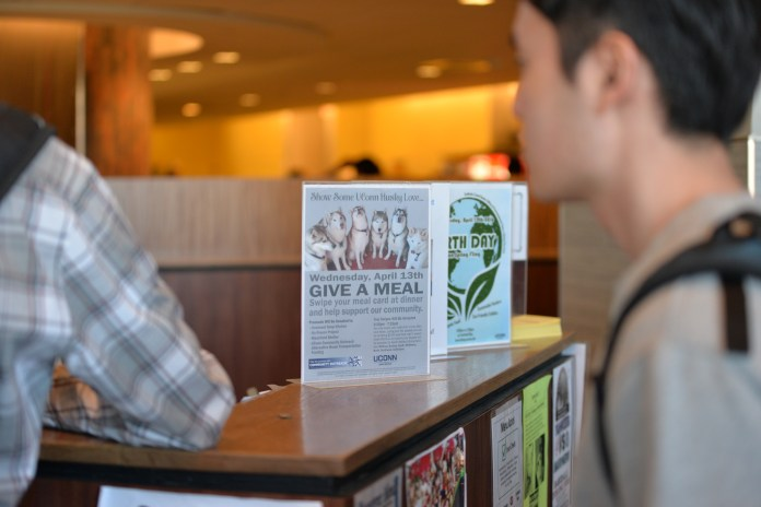 Give A Meal, an event by Dining Services that raises money by flex pass donations, is advertised in McMahon Dining Hall.(Amar Batra/Daily Campus)