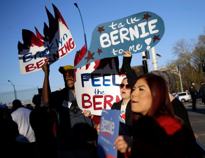 Supporters of Democratic presidential candidate Sen. Bernie Sanders, I-Vt, gather outside the Brooklyn Navy Yard before Sanders faces Hillary Clinton in the CNN Democratic Presidential Primary Debate on Thursday, April 14, 2016 in New York. (AP Photo/Seth Wenig)
