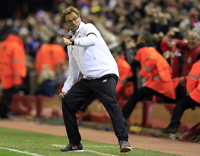 Liverpool's head coach Juergen  Klopp celebrates after his team scored during the Europa League quarterfinal second leg soccer match between Liverpool FC and Borussia Dortmund in Liverpool, England, Thursday, April 14, 2016 . (AP Photo/Jon Super)