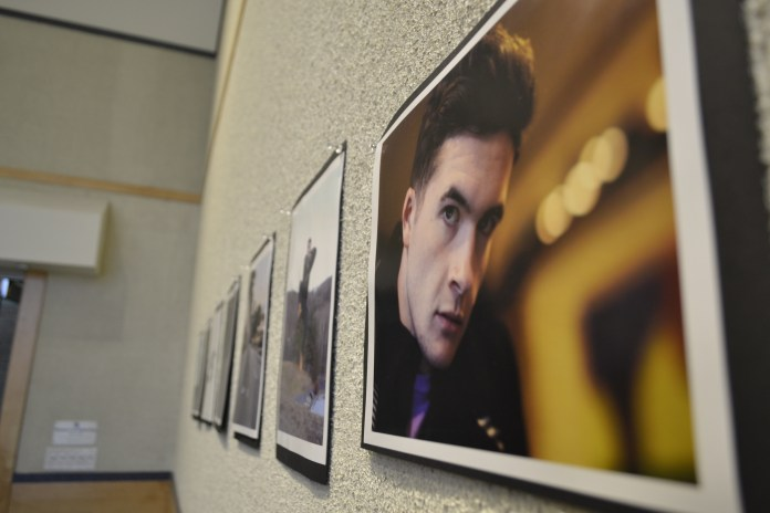 """Pictures line the walls during the University of Connecticut's SHAPE 'As I Am' art show. The gallery was covered with photographs of students from every race, sex and walk of life at UConn. The pictures featured car enthusiasts, ROTC cadets, strength athletes, """"Starcraft"""" gamers and dining hall employees. (Olivia Stenger/The Daily Campus)"""