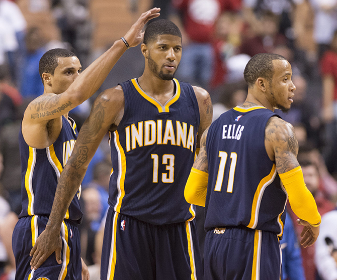 Indiana Pacers'Paul George (13), Monta Ellis (11) and George Hill (3) celebrate after defeating the Toronto Raptors 100-90 in Game 1 in the first round of the NBA basketball playoffs in Toronto, Saturday, April 16, 2016. (Frank Gunn/The Canadian Press via AP) ]