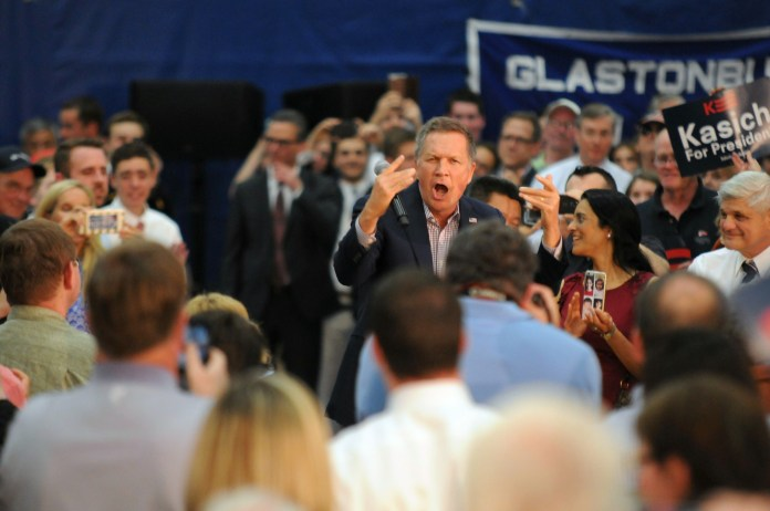 """Republican presidential candidate John Kasich danced onto the stage as Walk The Moon's """"Shut Up and Dance"""" played through the sound system during a town hall at Glastonbury High School on Friday, April 22, 2016.  (Kyle Constable/The Daily Campus)"""