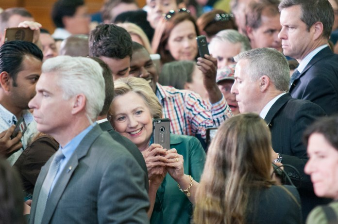 Democratic presidential candidate Hillary Clinton takes a selfie with a supporter after a campaign rally at the University of Bridgeport on Sunday, April 24, 2016. (Kyle Constable/The Daily Campus)