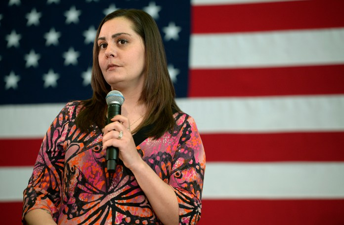Erica Smegielski, whose mother Dawn Hochsprung was principal of Sandy Hook Elementary School, and was killed in the December 2012 shooting at the school in Newtown, Conn., speaks during Democratic presidential candidate Hillary Clinton's campaign event, Thursday, April 21, 2016, in Hartford, Conn. Clinton stopped in Hartford for a discussion on gun violence prevention with family members of gun violence victims. (AP Photo/Jessica Hill)