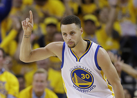 Golden State Warriors'Stephen Curry celebrates after scoring against the Houston Rockets during the first half in Game 1 of a first-round NBA basketball playoff series Saturday, April 16, 2016, in Oakland, Calif. (AP Photo/Marcio Jose Sanchez)