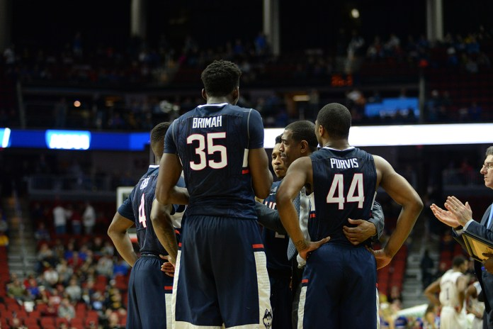Amida Brimah and Rodney Purvis huddle with their teammates during UConn's 73-61 loss to Kansas in the 2nd round of the NCAA Tournament on March 19, 2016. Brimah and Purvis announced Tuesday that they were withdrawing their names from consideration in the NBA Draft. (File photo/The Daily Campus)