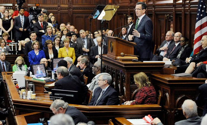 In this Feb. 3, 2016 file photo,Connecticut Gov. Dannel P. Malloy delivers an address to the senate and house inside the Hall of the House at the State Capitol in Hartford, Conn. (AP Photo/Jessica Hill, File)