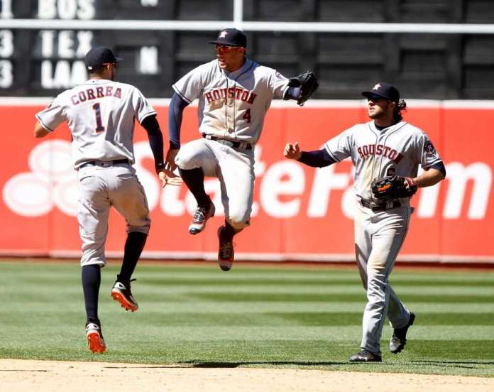 The Houston Astros' Carlos Correa (1) celebrates with teammates George Springer (4), and Jake Marshnick (6) after a 7-0 win against the Oakland Athletics on July 20, 2016, at the Coliseum in Oakland, Calif. (Photo courtesy of Aric Crabb/East Bay Times, via newsexpress.com)