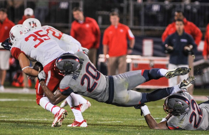 Defensive back Obi Melifonwu makes a tackle during a game against the Houston Cougars on November 21, 2015 at Pratt and Whitney Stadium in Hartford. (Bailey Wright/The Daily Campus)