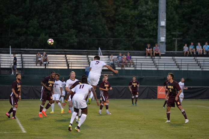 Jacob Hauser-Ramsery rises for a header in UConn's season opening 3-1 victory over Iona at Morrone Stadium on Aug. 26, 2016. (Amar Batra/The Daily Campus)