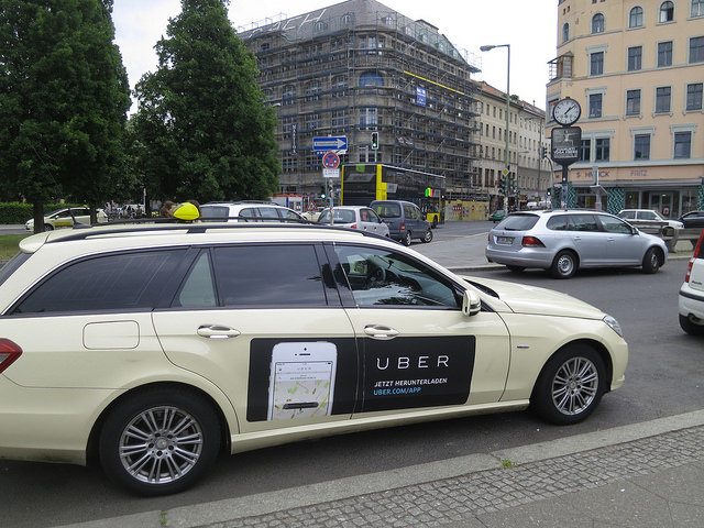 An Uber ad on the side of a car in Berlin. A student was hit by an Uber driver on Friday, Aug. 26, 2016. (Flickr/ Alper Çuğun )