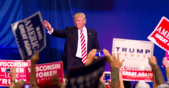 Republican presidential nominee Donald Trump waves to supporters as he walks off the stage at his campaign rally Tuesday, Aug. 16, 2016 in West Bend, Wis. (John Ehlke/West Bend Daily News via AP)